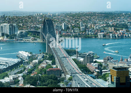 Looking towards the southern approaches and exits from the Sydney Harbour Bridge and across the harbour to the north shore. - Stock Image
