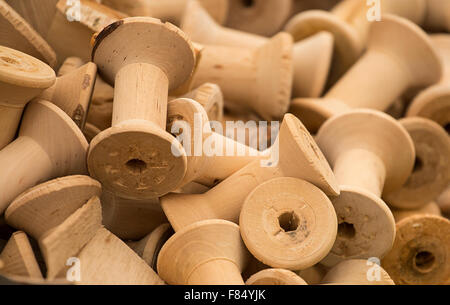Bobbins traditionally manufactured for wrappng thread, twine or string around great background for traditiona craftl - Stock Image