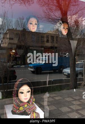 Islamic veil (hijab) shop window, Yazd, Iran - Stock Image
