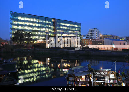 Kings Place, looking across Regents Canal from Granary Square, at dusk, in north London, UK - Stock Image