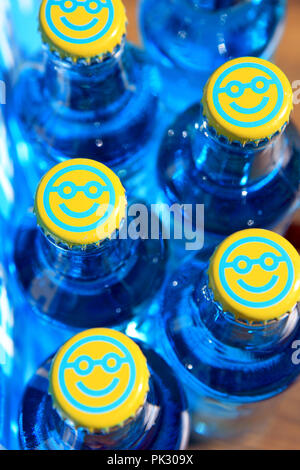 WKD Original Vodka Bluer bottles with smiley faced bottle tops - Stock Image
