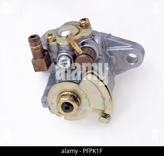 Oil pump showing the oil inlet, oil delivery outlet, mounting hole and control cable slot. - Stock Image