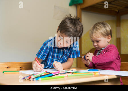 Brothers drawing with colored pencils, Munich, Germany - Stock Image