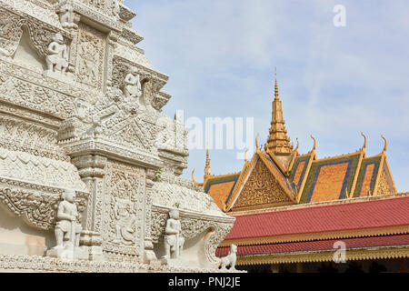 Detail of Silver Pagoda design with the Throne Hall roof in the background. Inside the Royal Palace complex in Phnom Penh, Cambodia. - Stock Image