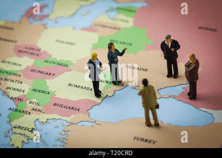 figurines standing on the europe map around the azov and black sea - Stock Image