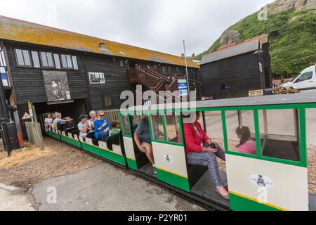 Passengers in Hastings Miniature InterCity Railway. Hastings, East Sussex, England , UK - Stock Image