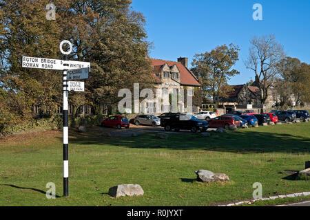 Signpost outside the Mallyan Spout Hotel Goathland North York Moors National Park North Yorkshire England UK United Kingdom GB Great Britain - Stock Image