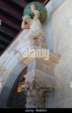 Statue of the God Atlas in the Doges palace in Venice - Stock Image