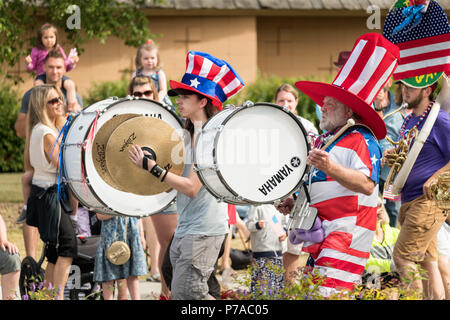 Anchorage, Alaska. 4th July, 2018. A marching band in patriotic colors marches in the annual Independence Day parade July 4, 2018 in Anchorage, Alaska. Credit: Planetpix/Alamy Live News - Stock Image