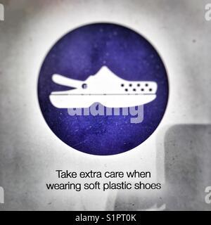 Plastic shoe / crock sandal warning - Stock Image