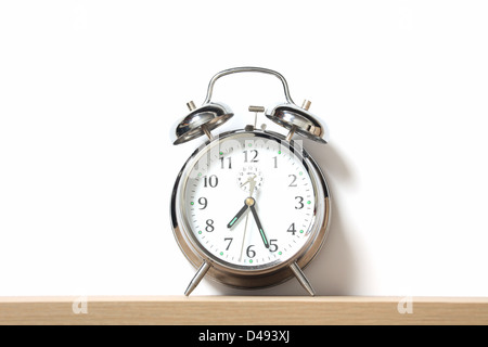 Chrome alarm clock with bells on, set just after 7-25. - Stock Image