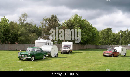 Triumph Herald and Triumph Vitesse cars towing trailers, Lauder, Scotland, UK - Stock Image