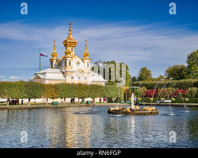 18 September 2018: St Petersburg, Russia - The East Square Pond with a fountain, and the East Chapel of the Peterhof Grand Palace. - Stock Image