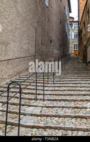 Steep steps in the city of Le Puy-en-Velay in the Auvergne-Rhone-Alpes region of south-central France. - Stock Image