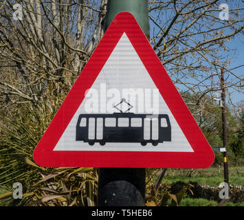 Tram crossing sign at Colyton Station on the Seaton tramway, Devon, UK - Stock Image