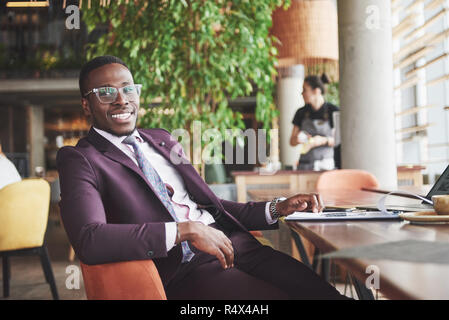 Happy smile of a successful African American businessman in a suit. - Stock Image
