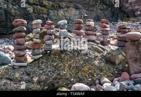 Dunbar, East Lothian, Scotland, UK. 21st Apr 2019. European stone stacking championship:  Balanced stones by Jonathon Kitching, from Aboyne Scotland, in the artistic competition, giving competitors 3 hours to create anything from stones or found objects at Eye Cave beach on the second day which comprises 2 competitions, a 3 hour artistic challenge and a children's competition. The overall winner receives a trip to llano Earth Art Festival & World Stone Balancing competition in Texas in 2020. Credit: Sally Anderson/Alamy Live News - Stock Image
