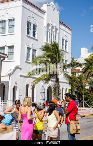 Miami Beach Florida Ocean Drive New Year's Day Art Deco District sidewalk cafe alfresco al fresco dining pedestrian Asian man - Stock Image