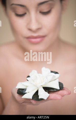 Woman offering flower - Stock Image