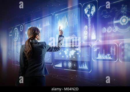 futuristic interface. woman engineer touching virtual screens. - Stock Image