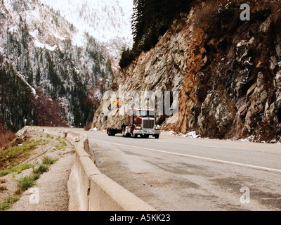Semi truck making itÕs way through the Cascade Mountains of Highway 2 2003 - Stock Image