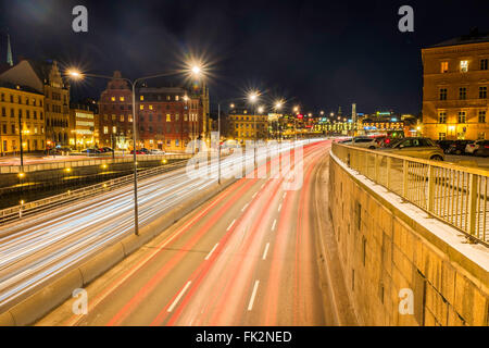 Night view of 'Central Bridge', Centralbron, Stockholm looking south from Riddarholmsbron. Car lights create - Stock Image