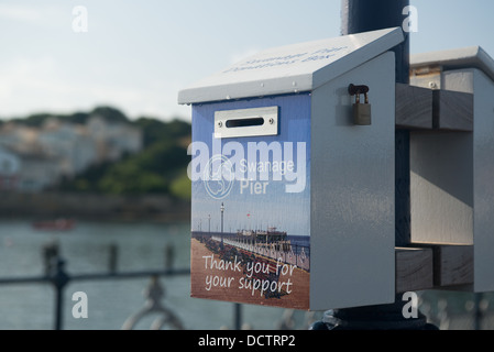 Donation box for Swanage pier, Dorset - Stock Image
