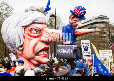 London, UK. 23 March 2019. Brexit float featuring Theresa May designed by German designer Jacques Tilly. Remain supporters and protesters take part in a march to stop Brexit in Central London calling for a People's Vote. - Stock Image