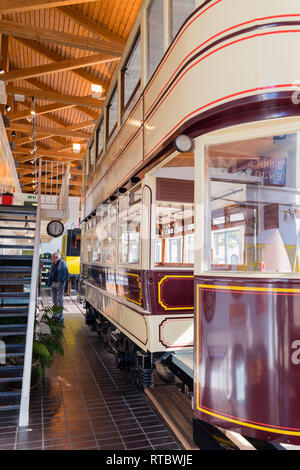 A double decker tram inside the Tram Shed, the tram museum on the marina waterfront at Swansea, South Wales - Stock Image
