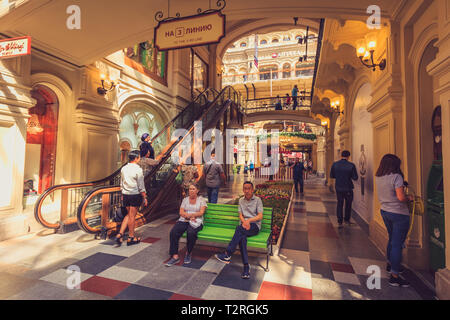 Moscow, Russia - July 31, 2018: Staircase escalator interior in the State Department Store in Moscow with tourists - Stock Image