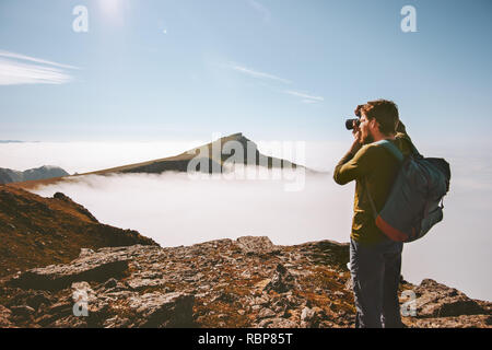 Man travel photographer with camera in mountains Travel freelancer blogger lifestyle hobby concept adventure summer voyage outdoor - Stock Image