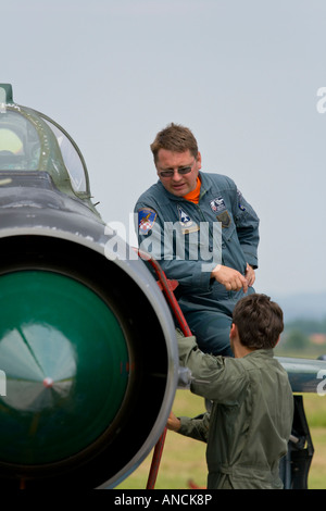 Aviation mechanics chat, Croatian Air Force MiG-21 bisD fighter, Pleso AFB during 'open day' visit in 2007 - Stock Image