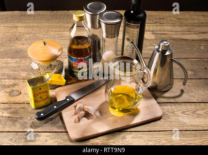 Mixing the ingredients for vinaigrette, salad dressing, french dressing , italian dressing - Stock Image
