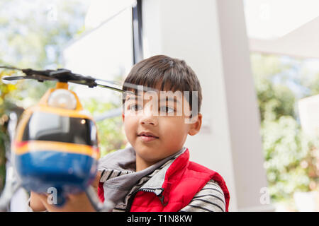 Boy playing with toy helicopter - Stock Image