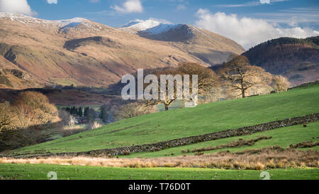 English lake district. A view from the Keswick to Windermere road with the snowy ridge of Helvellyn in the distance. - Stock Image
