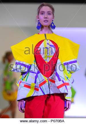 Southampton, England, UK,  8th June 2018. Solent university tonight held its BA (HONS) Fashion graduate show in Southampton to showcase the skills and imagination of the final year students. A colourful collection by Claire House inspired by relationships between life, mind and functions of the body. Credit: PBWPIX/Alamy Live News - Stock Image