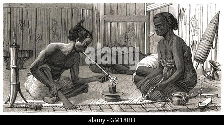 """Malay Opium-Smokers"" illustration showing Malays smoking opium. Chinese immigrants introduced the habit in the - Stock Image"