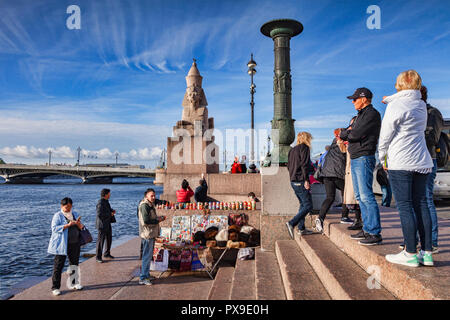 18 September 2018: St Petersburg, Russia - Tourists sightseeing at Quay with Sphinxes, on the banks of the River Neva, with the 3500 year old Sphinx b - Stock Image