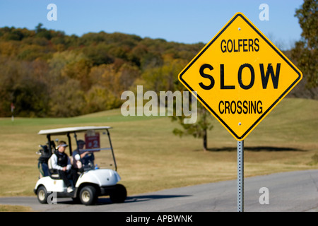 Golfers make their way on a path in their golf cart at Country Club Golf Course in Bella Vista, Ark. - Stock Image