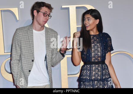 London, UK. 27th September 2018. Young and kink handcuffs to each other Callum Airey (L) and Emily Canham attend A Star Is Born UK Premiere at Vue Cinemas, Leicester Square, London, UK 27 September 2018. Credit: Picture Capital/Alamy Live News - Stock Image