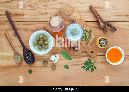 Assortment of herbs rosemary ,thyme,sage, mint,bay leaves , pepper and parsley set up with wooden background concept - Stock Image