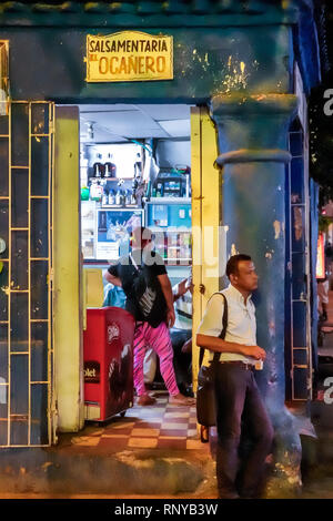 Cartagena Colombia Old Walled City Center centre Getsemani night nightlife Hispanic resident residents salsamentaria delicatessen charcuterie doorway - Stock Image