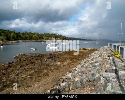 Boats moored in Armadale Bay by Armadale Pier, Isle of Skye, Scotland, UK - Stock Image