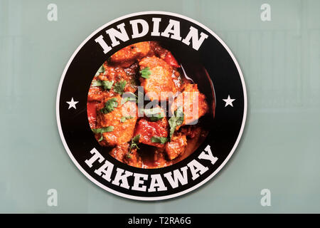 An Indian takeaway sign outside a Seville restaurant - Stock Image