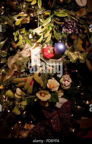 Close up of Christmas ornaments on tree - USA - Stock Image