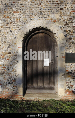 Norman south door, St Mary's Church, Buckenham, Norfolk - Stock Image