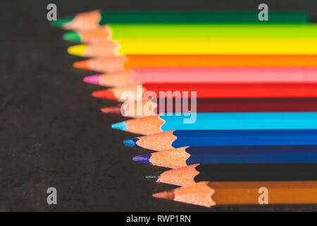 Coloured pencils lined up in a row - colourful concept - Stock Image