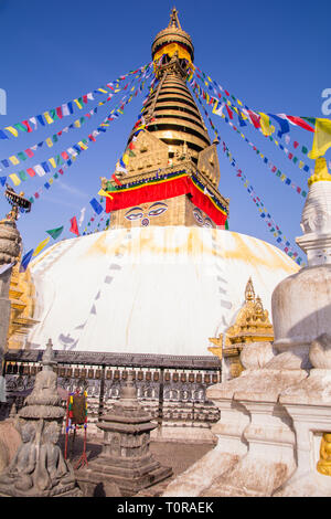 Swayambhunath or Monkey temple is an ancient religious architecture atop a hill in the Kathmandu Valley with a clear blue sky from Swayambhu, west of  - Stock Image