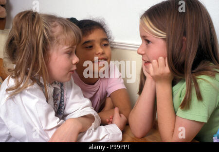 three young girls chatting - Stock Image