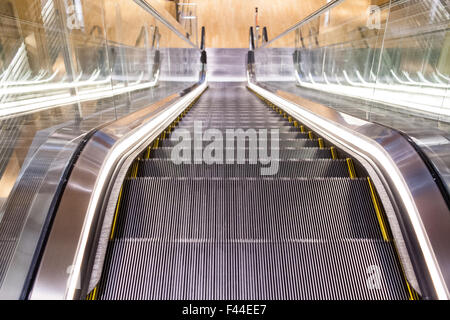 Escalator viewed from top down centered - Stock Image
